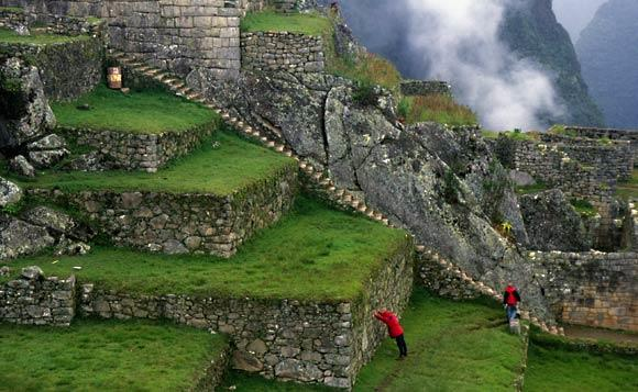 Tourists climb the stone stairs of Machu Picchu in 1995.