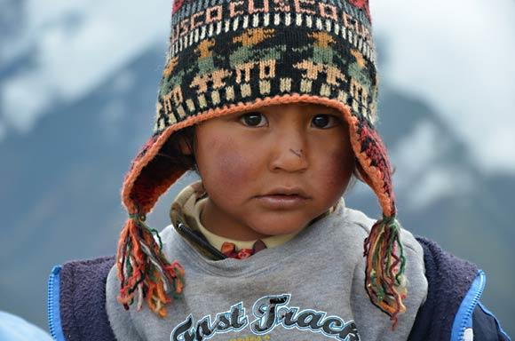 A roadside vendor's son stands on a high ridge above the Sacred Valley. Photo taken in 2011.