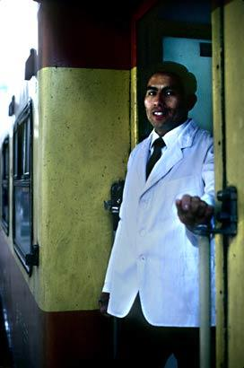A waiter pauses between stops on a train outside Cuzco. Photo taken in 1988.