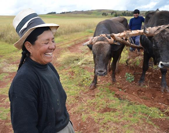 Near the ruins of Moray in the Sacred Valley, a farmer jokes with visitors. Photo taken in 2011.