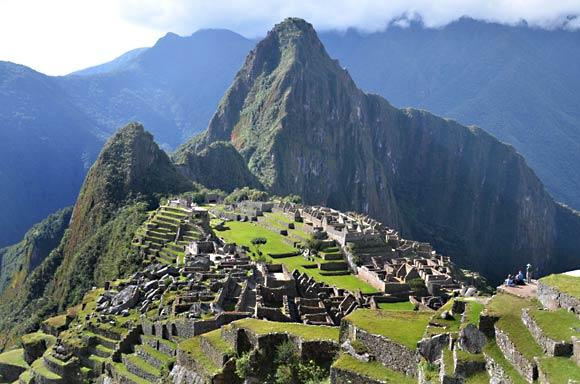 In the classic view of the Machu Picchu ruins, the peak of neighboring Wayna Picchu stands tall in the background.