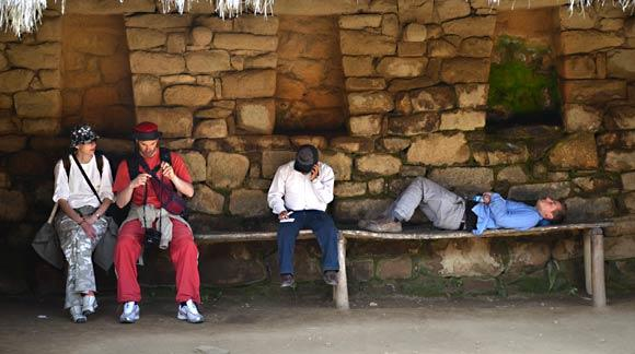 Tourists take advantage of rare shade atop Machu Picchu. Photo taken in 2011.
