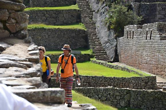 Machu Picchu doesn't change much, but as hikers pass, the fashion show is endless. Photo taken in 2011.