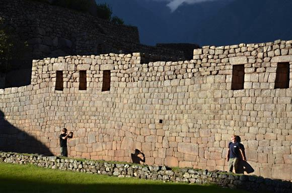 With the day nearly done and Machu Picchu emptying of visitors, these two German tourists used the ruins as a set for a mock fashion shoot. Photo taken in 2011.
