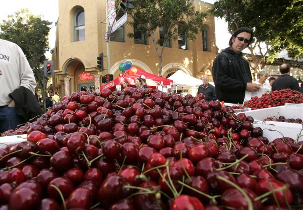 Cherries tempt shoppers at a farmers market in San Luis Obispo, Calif.