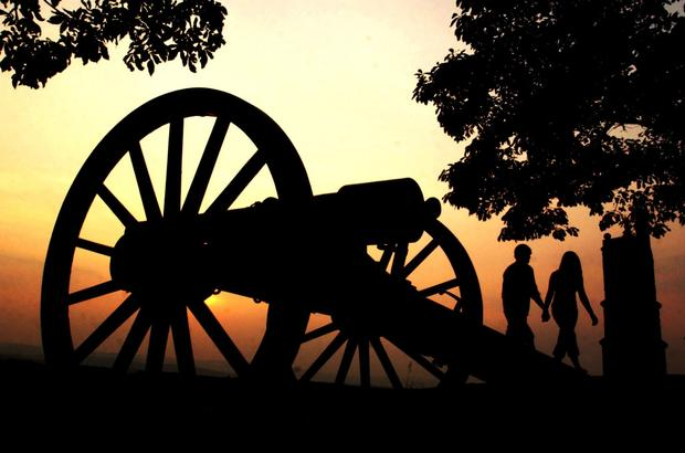 Visitors stroll past a cannon on Little Round Top at Gettysburg National Military Park. Gettysburg,  Pa., is marking the 150th anniversary of the key Civil War battle this year.