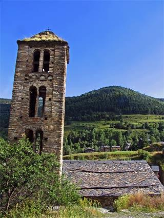 <b>Andorra</b><br> <br> The campanile of Sant Climent de Pal, one of Andorra's many beautiful Romanesque stone churches, towers over the verdant countryside.  The tiny landlocked country is nestled in the Catalonian Pyrenees between France and Spain.