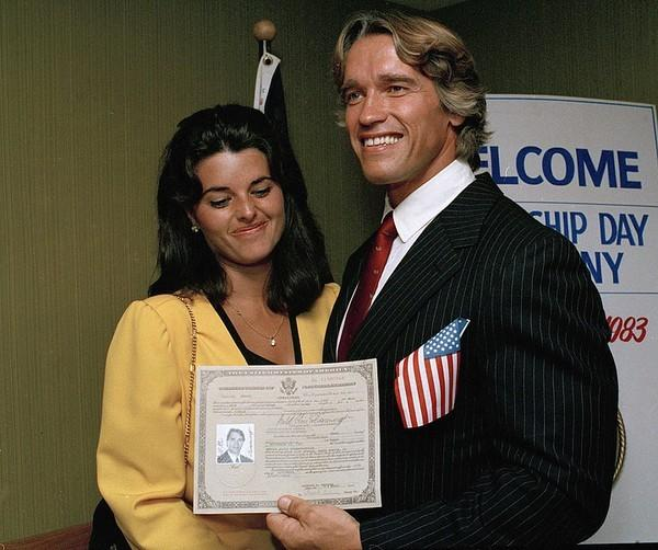 Arnold Schwarzenegger and Maria Shriver with Schwarzenegger's U.S. citizenship papers on Sept. 16, 1983.
