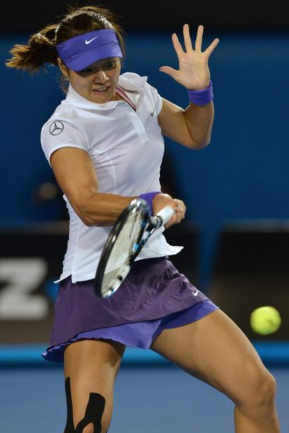Li Na returns a forehand shot against Victoria Azarenka in the women's final on Saturday.