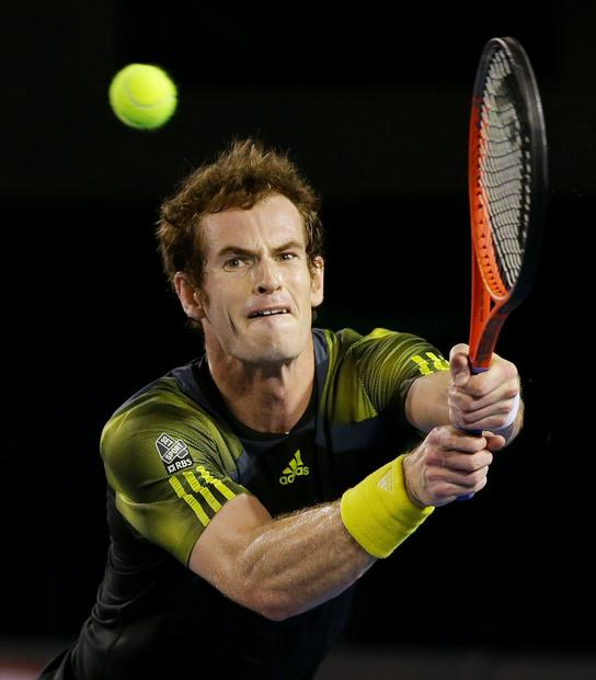 Andy Murray stretches to get to a backhand return against Novak Djokovic in the Australian Open men's championship match.