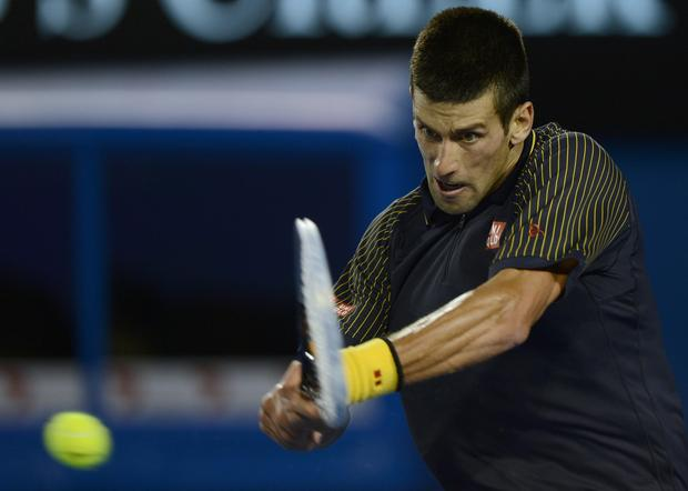 Novak Djokovic gets into a backhand return against Andy Murray in the men's final of the Australian Open.