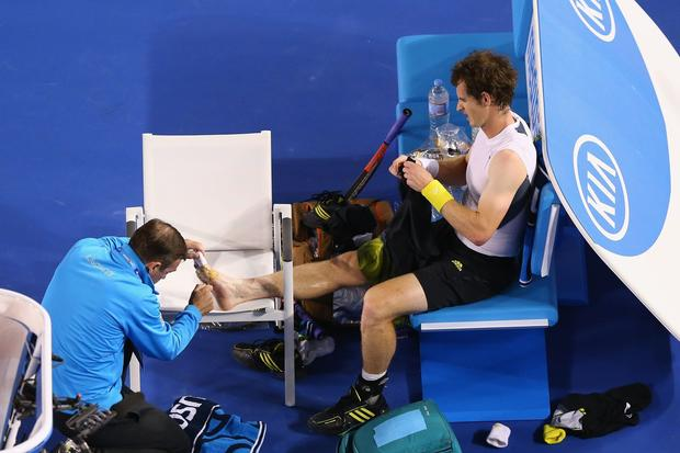 Andy Murray receives medical treatment for his big toe and foot during the final of the Australian Open on Sunday.
