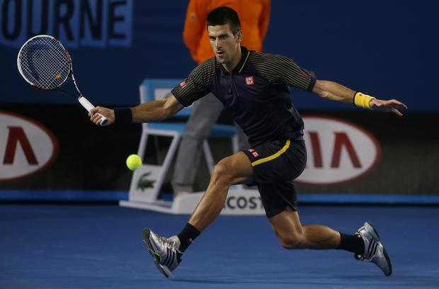 Novak Djokovic tracks down a forehand return against Andy Murray in the men's final of the Australian Open on Sunday.