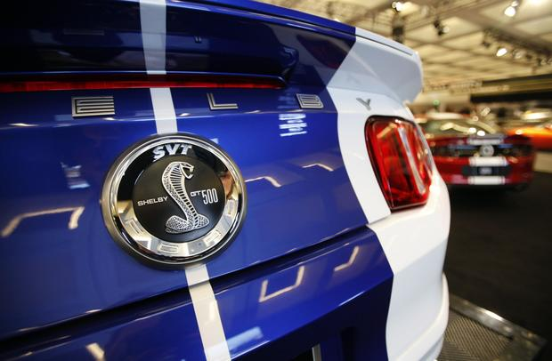 The 2012 Custom Shelby GT 500 Wide Body by Galpin Auto Sports, left, with the 2013 GT 500 Super Snake by Shelby/Galpin Auto Sports in the background.