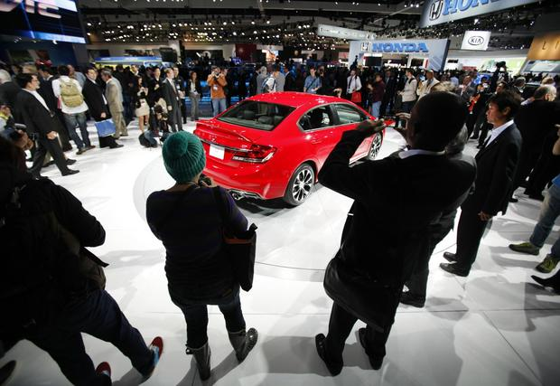 The 2013 Honda Civic draws a crowd.