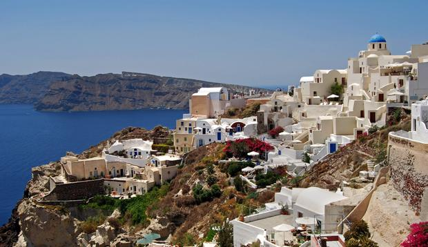 Oia, a town on the northwest end of Santorini, is dotted with white villas all the way down the lava cliffs to the sea.
