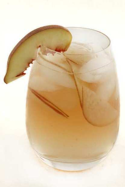 "The white hot peach sangria, adapted from a recipe from Cafe del Rey in Marina del Rey. <a href=""http://www.latimes.com/features/food/la-fo-sos-peachsangria-20110915,0,2631839.story"">Recipe</a>"