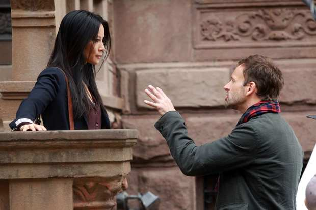"Lucy Liu and Jonny Lee Miller on location in Manhattan for the filming of ""Elementary."""