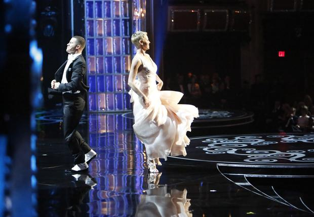 Channing Tatum and Charlize Theron perform as part of the opening sequence.