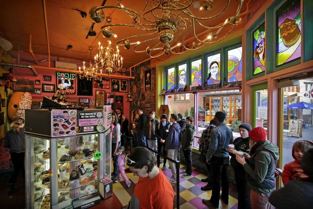 The lines at Voodoo Doughnut sometimes stretch out out the door.