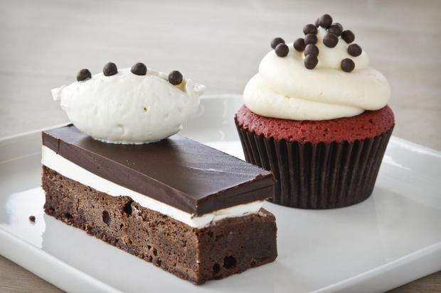 The nananino, a peppermint chocolate brownie, left, and a red velvet cupcake.