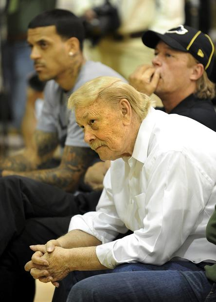 Lakers owner Jerry Buss and son Jim listen along with player Matt Barnes to new head coach Mike Brown during a news conference in El Segundo.