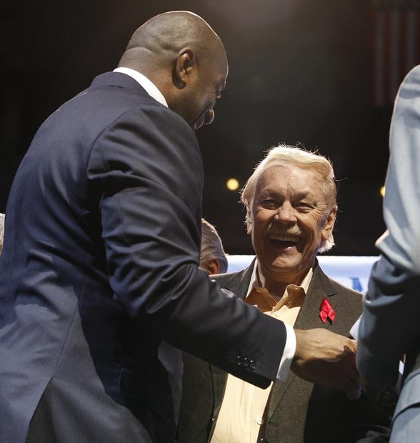 "Ervin ""Magic"" Johnson, is greeted by Lakers owner Jerry Buss at a Staples Center news conference marking the 20th anniversary of Johnson's retirement as a professional basketball player."