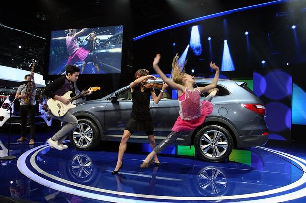 Singers perform for the unveiling of Hyundai's 2013 Santa Fe at the L.A. Auto Show at the Los Angeles Convention Center in Los Angeles on November 28, 2012.
