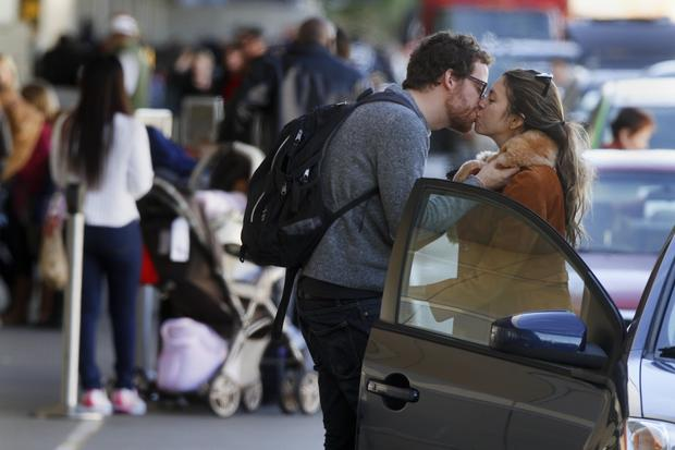 Chase Sampson kisses his girlfriend Alexis Justman goodbye at LAX as he heads to Atlanta for the holidays.