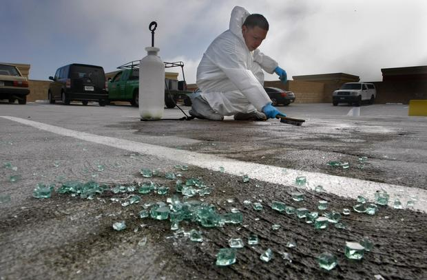 David Zavala cleans up the crime scene on the top floor of a parking structure, located in an upscale, high-security condominium complex where Monica Quan and her fiance Keith Lawrence were killed.