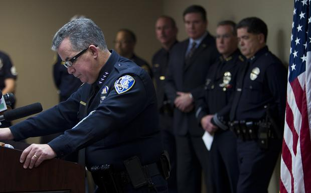 Riverside Police Chief Sergio Diaz looks down as he announces that the 34-year-old officer killed in the early morning shooting was an 11-year veteran of the department during a press conference at the Magnolia Facility of the Riverside Police Department. Two officers were shot at the corner of Magnolia and Arlington avenues. The officers were sitting at a red light when they were ambushed. One was killed, the other was still in surgery Thursday morning. The alleged shooter is fired LAPD officer Christopher Jordan Dorner,33.