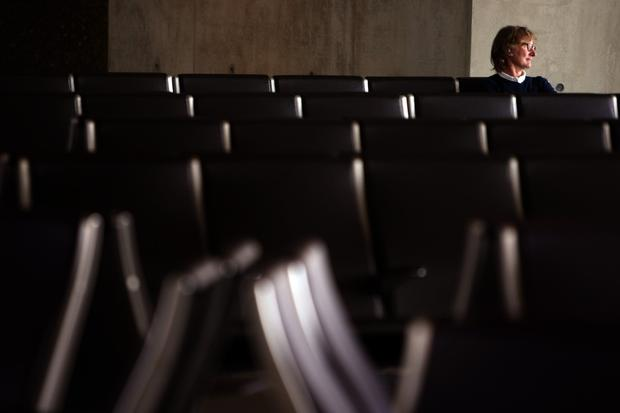 Lars Granstrand waits for his flight among a sea of empty chairs in the new north concourse of the Tom Bradley International Terminal.