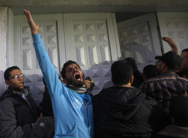 Palestinian men react at the hospital after the body of Ahmed Jabari, head of the Hamas military wing, was brought in.
