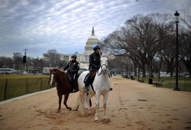 Mounted park police officers patrol the National Mall.