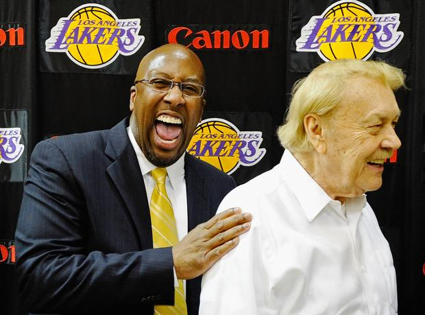 Mike Brown, left, the new head coach of the Los Angeles Lakers, laughs with team owner Jerry Buss after Brown's introductory news conference at the team's training facility on May 31, 2011 in El Segundo. Brown replaced coach Phil Jackson, who retired at the end of the season.