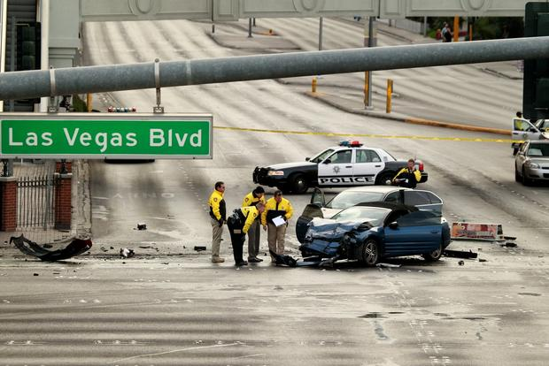 Law enforcement authorities investigate the scene of a multi-vehicle accident after gunfire at Las Vegas Boulevard and Flamingo Road.