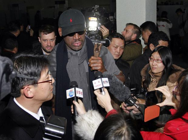 "Former NBA star Dennis Rodman is surrounded by journalists upon arrival at Pyongyang Airport, North Korea. The American known as ""The Worm"" became an unlikely ambassador for sports diplomacy at a time of heightened tensions between the U.S. and North Korea."