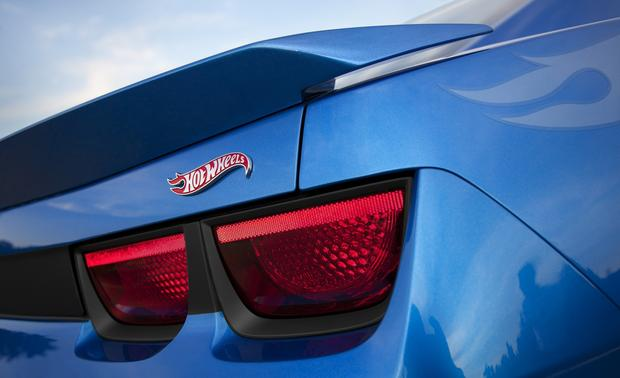 The red Hot Wheels flame logo will adorn the full-size version's trunk lid.