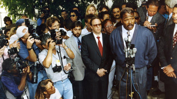 Rodney King, speaking to the media outside of his lawyer's office in Beverly Hills on May 1, 1992, asks for an end to the killing, looting and destruction that his case against the LAPD caused.