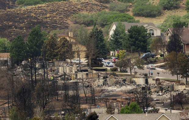 THE WALDO CANYON FIRE tore a path of destruction through a neighborhood in Colorado Springs, Colo. More people live closer to lands that are vulnerable to wildfires, meaning higher damage totals.