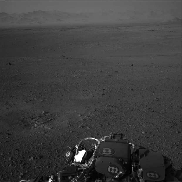 This image released by NASA on Wednesday, taken by cameras aboard the Curiosity rover, shows the Martian horizon. It's one of dozens of images that will be made into a panorama. Curiosity landed Sunday on a two-year mission to study whether its landing site ever could have supported microbial life.