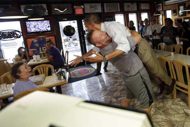 President Obama is lifted off the ground by restaurant owner Scott Van Duzer during a visit to Duzer's Big Apple Pizza in Fort Pierce, Fla.