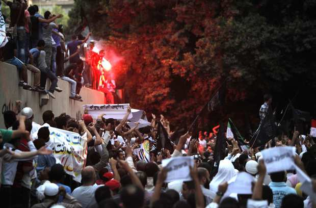 Egyptian protesters angry over what they say is an anti-Muslim video demonstrate at a wall of the U.S. Embassy in Cairo. As many as 2,000 demonstrators had rallied outside the embassy earlier in the day to protest video footage posted on  YouTube that demonstrators said had been made by Egyptian Coptic immigrants in the United States.