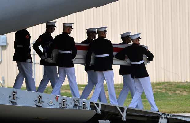 Marines carry a casket during the transfer of remains ceremony marking the return to the U.S. of the remains of the four Americans killed in an attack in Benghazi, Libya.