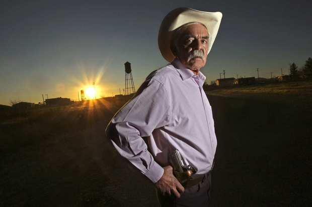 Javier Lozano is the pistol-packing municipal judge in Columbus, N.M., where the mayor, police chief and a city trustee pleaded guilty in a scheme to smuggle guns across the nearby U.S.-Mexico border. If Mexican cartel violence isn't stopped, he said, more U.S. communities are likely to experience similar disgraces