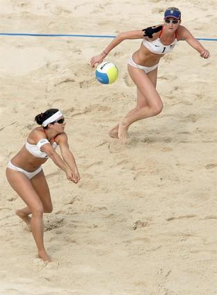 Misty May-Treanor makes a pass to teammate Kerri Walsh during their preliminary round victory over Cuba on Aug. 12 in Beijing.