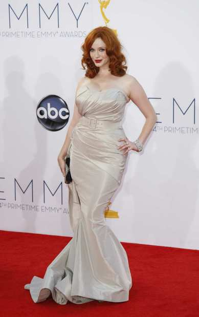 "Christina Hendricks played a modern-day Marilyn Monroe in a silver strapless gown by ""Project Runway"" vet Christian Siriano."