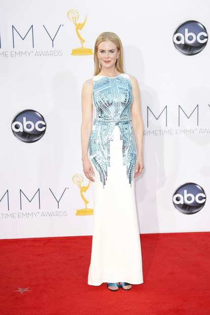 Nicole Kidman exemplified the less-is-more style philosophy in a sleek white column dress with scale-like sequin detail by Antonio Berardi.