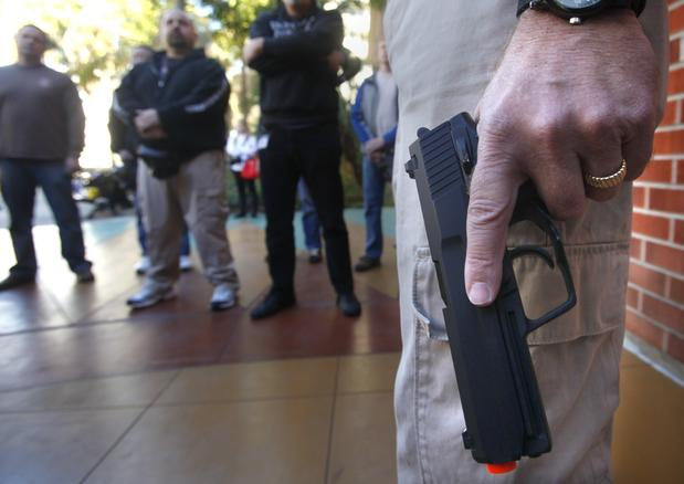Instructor Bret Bandick holds an airsoft gun as he acts as a shooter at the Olmeca Residence Hall at San Diego State while police officers and school officials participate in the training exercise. The two-day Active Shooter Response Training aims to teach college and school officials and others what to do in the event of a mass shooting.