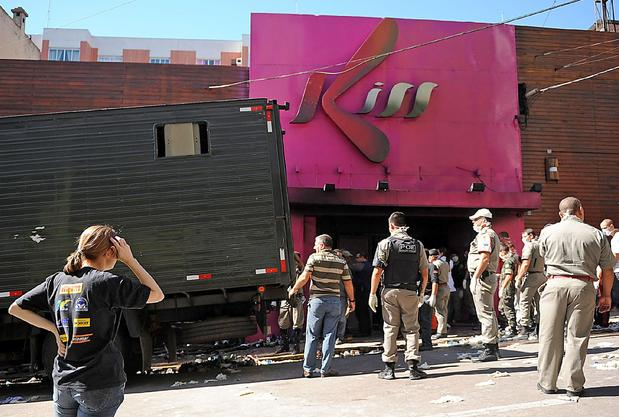 Rescue workers investigate the fire at the Kiss nightclub in Santa Maria, Brazil.